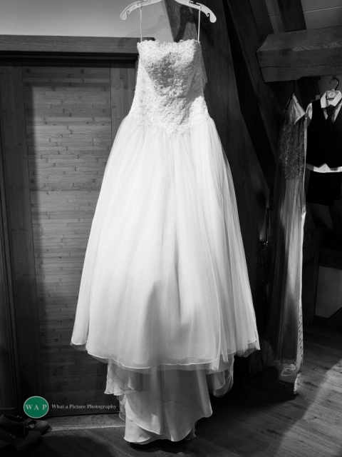the wedding dress by What a Picture Photography at Redhouse Barn