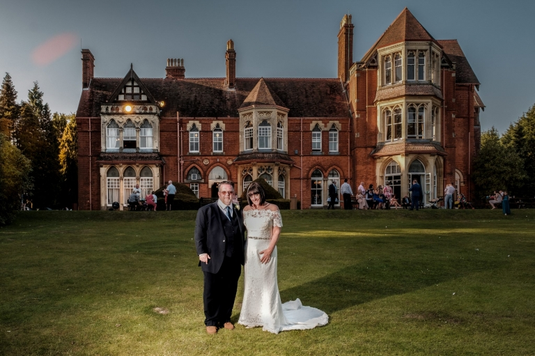 Bride and groom with Highbury Hall - Kings Norton Wedding Photographer