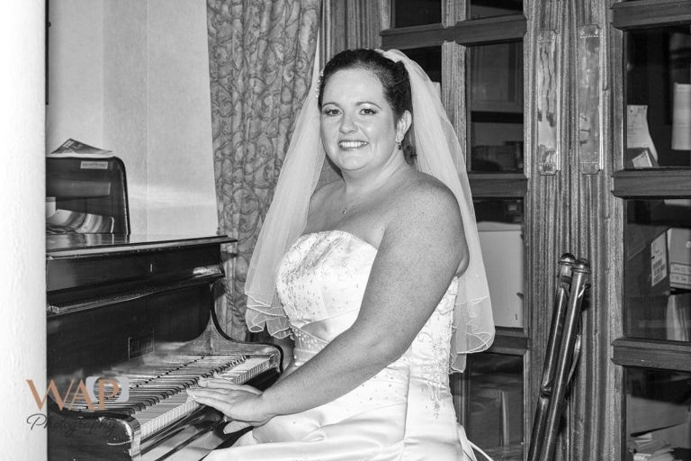 Piano Playing bride by Solihull Wedding Photographer - What a Picture Photography